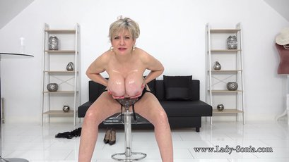 Busty Lady Sonia removes her underwear as you wank