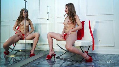 Bjorg Larson sexily teases herself by the mirror
