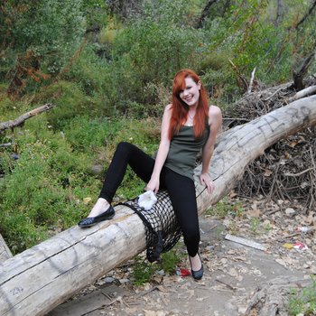 Cute ginger girl with long hair does posing