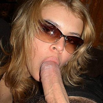 Stunner wearing sunnies and giving head