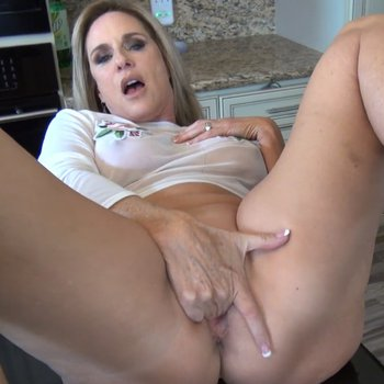 Jodi West fingering her pussy in the kitchen